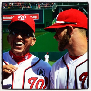 Davey Johnson and Bryce Harper share a laugh during the Nats' Opening Day ceremonies Monday.
